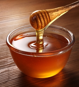 How does perforated metal help with honey production?