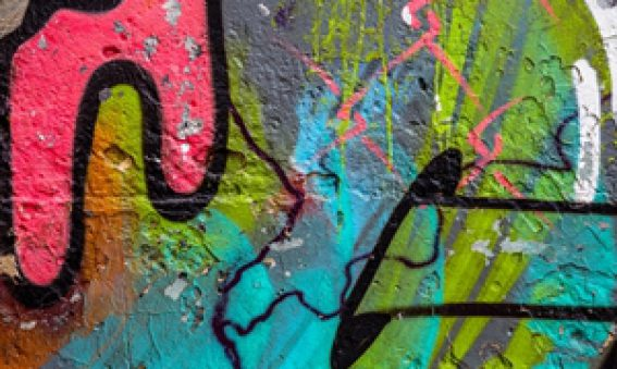 How can metal facades help protect your building from graffiti?