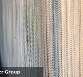 How can wire mesh curtains be utilised in architecture and interior design?