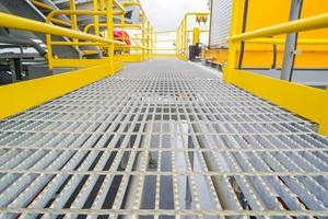 Aluminium floor grating is often chosen as a lightweight option.