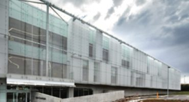Woven mesh is one of many decorative metal options for buildings.